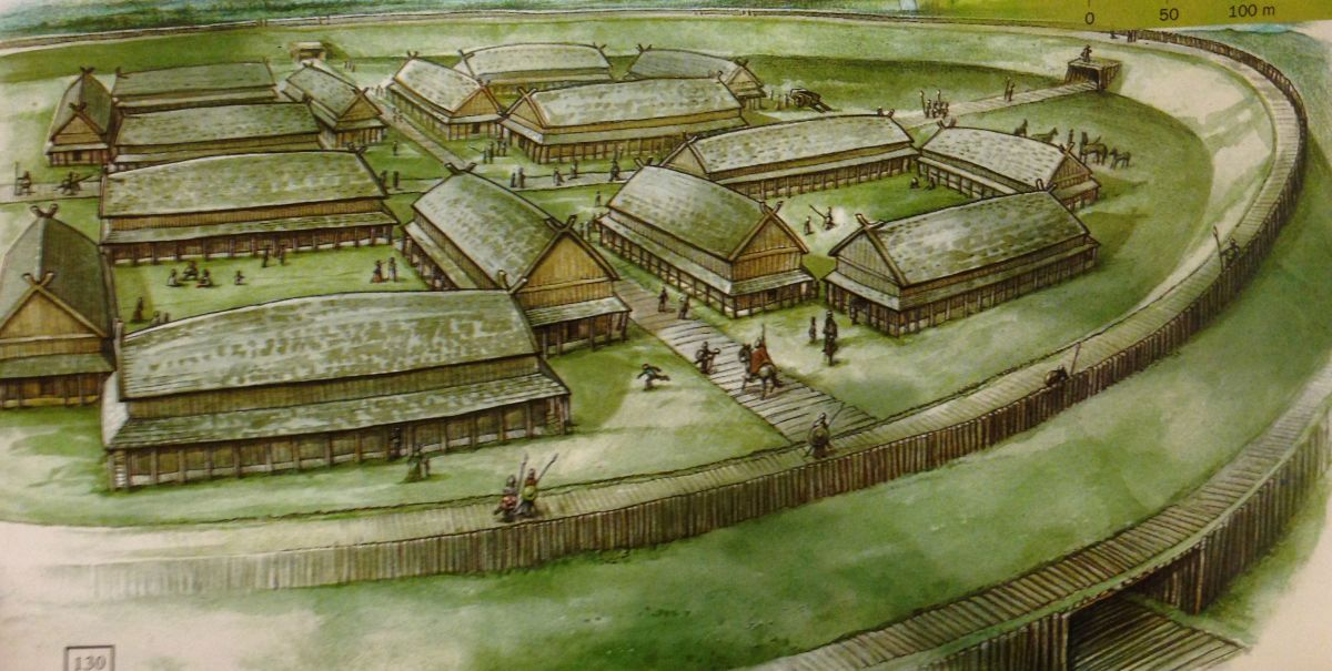 A reconstructed camp shows a timber-built roadway and buildings layout
