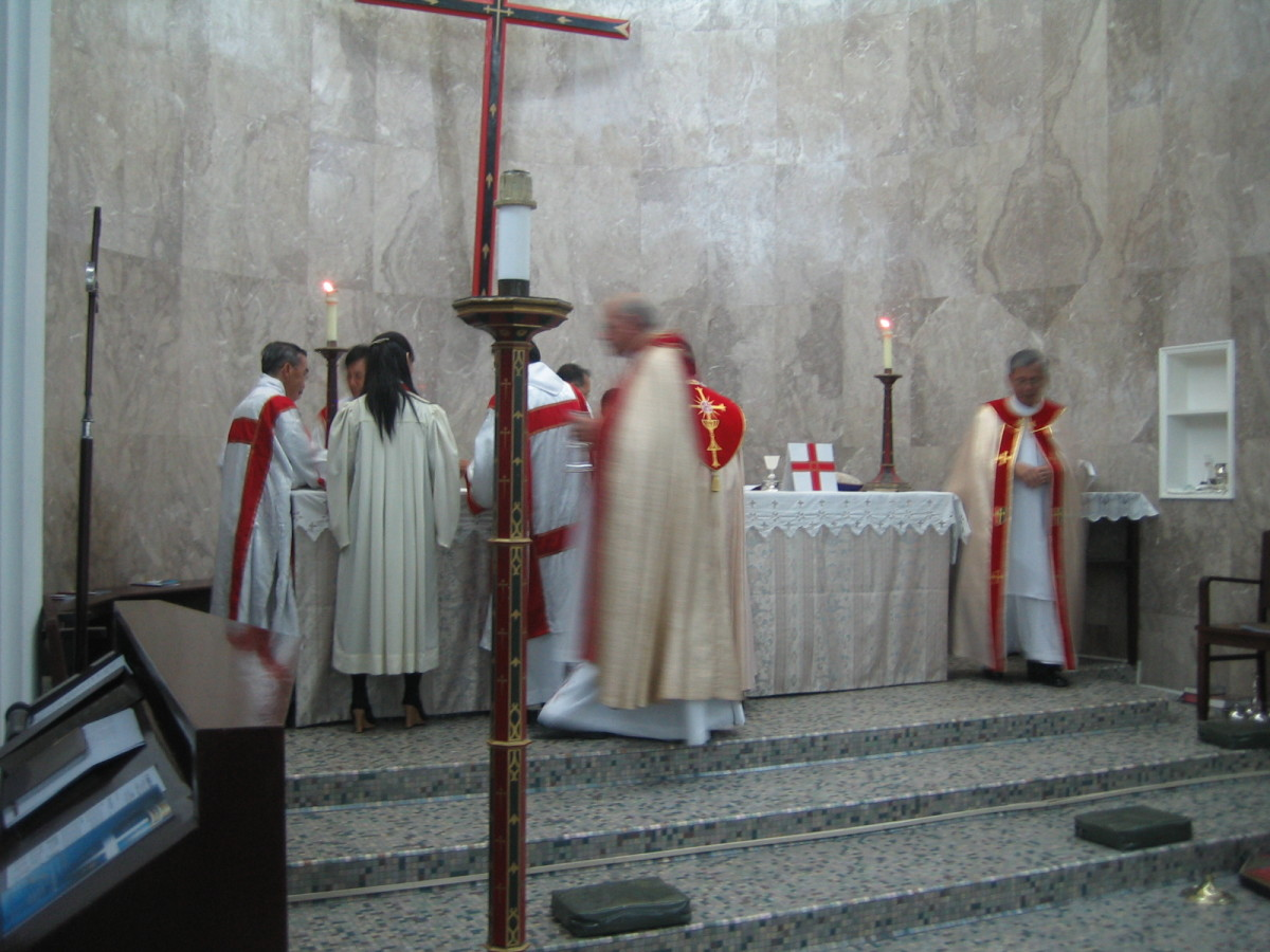 A Sub-Deacon (left) assisting at the Sanctuary during the Installation of the 4th Archbishop of the Anglican Church in the Province of Southeast Asia.