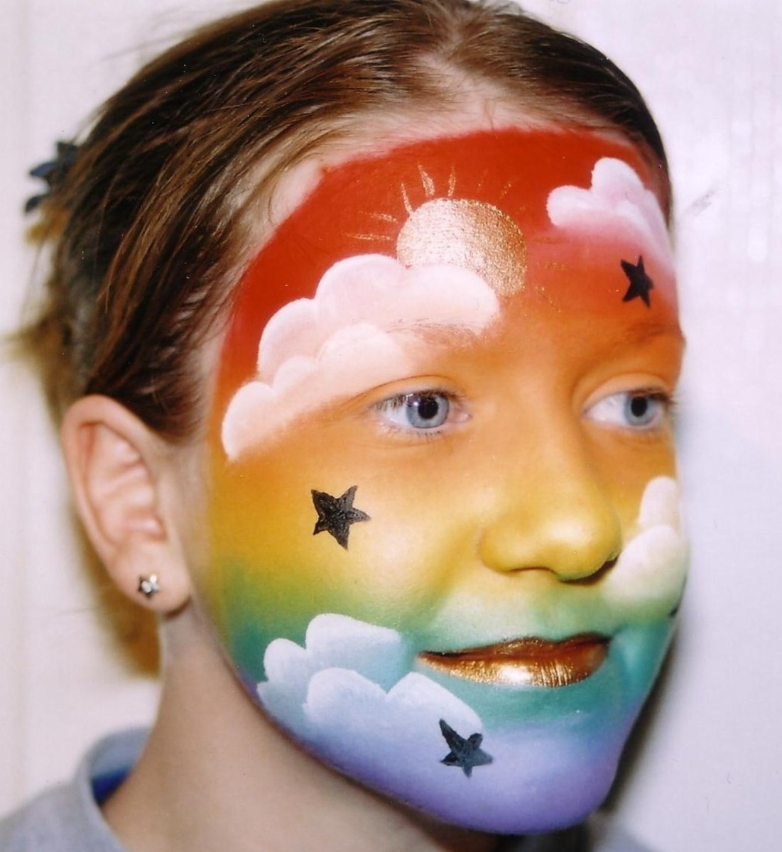 Star face painting for children designs tips and tutorials star and rainbow face painting sciox Images