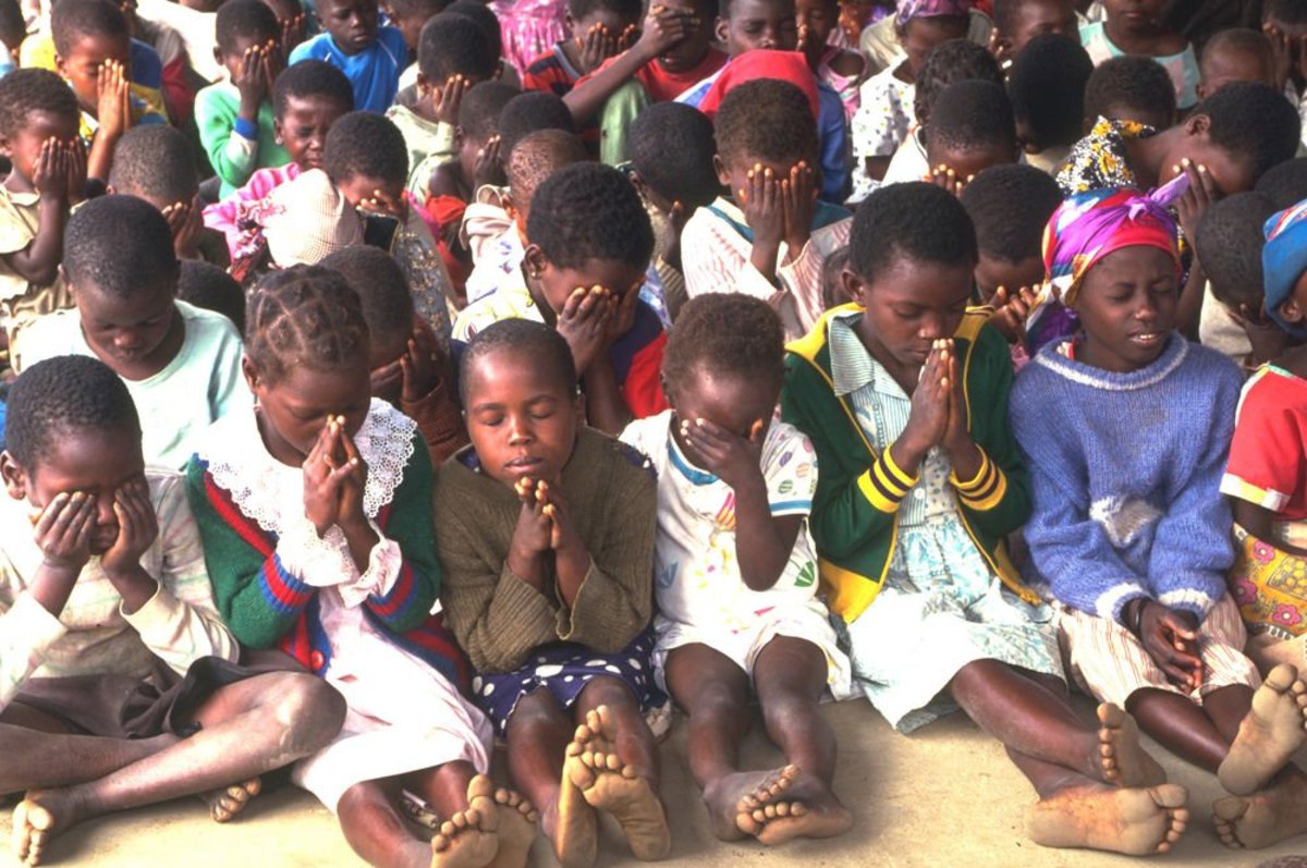 African children praying.