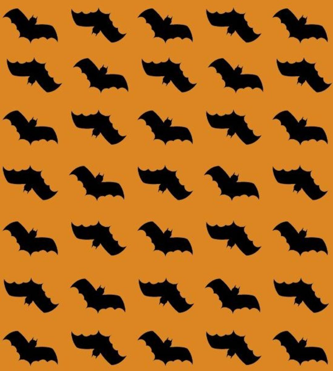 Printable Halloween vampire bats pattern black and orange.