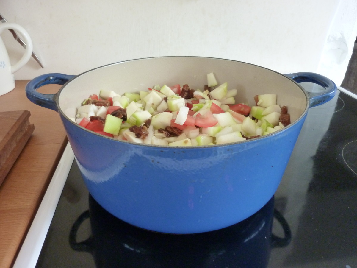 Put marrow, tomatoes, dates and onions in a heavy, flatbottomed pan on a medium heat.
