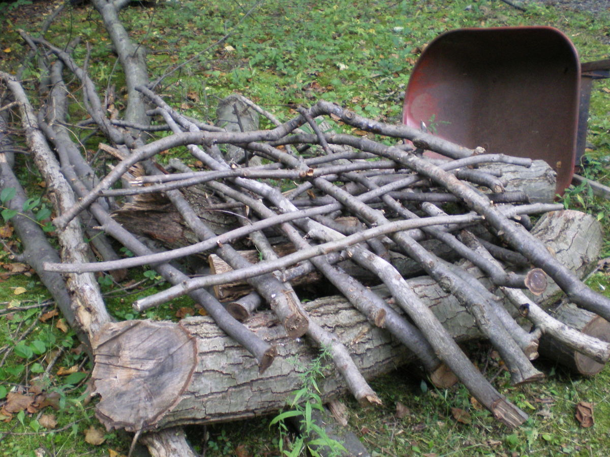 Interweave the branches at the base for a more stable pile.  This method also leaves lots of room for birds to enter and explore.