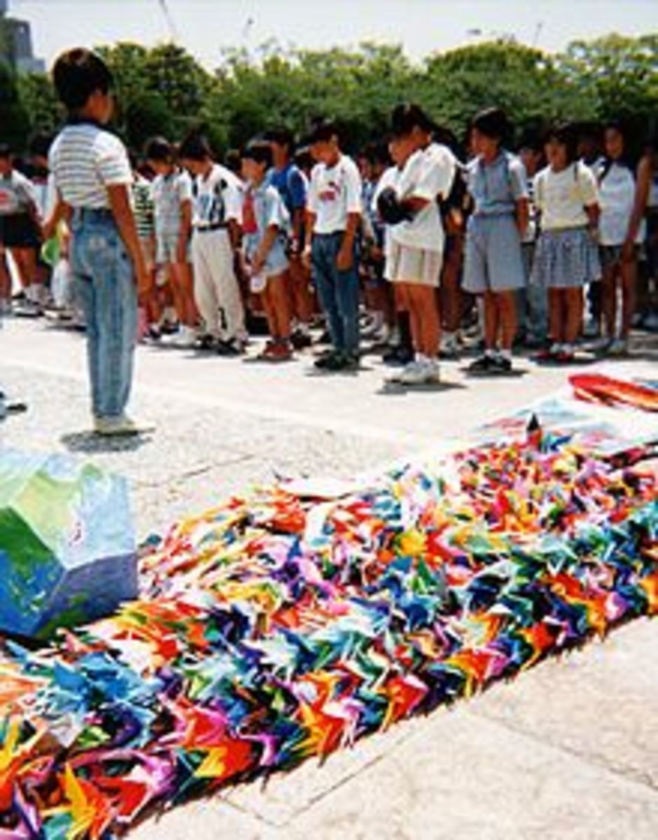 A group of Japanese schoolchildren dedicate their contribution of a thousand origami cranes at the Sadako Sasaki memorial in Hiroshima.