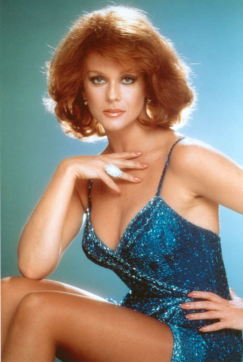 Ann Margaret is beauty in motion when she dances in her turquoise outfit.