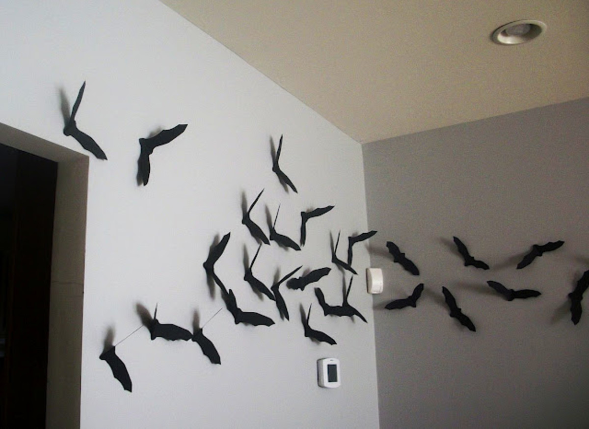 Bats flying around the corner of the room.