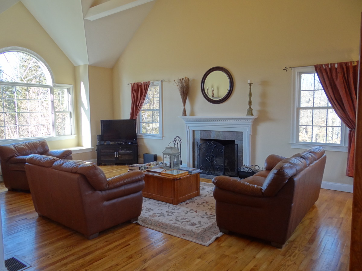 The vaulted ceilings of my family room, shown here, did not compliment the shabby chic decor.