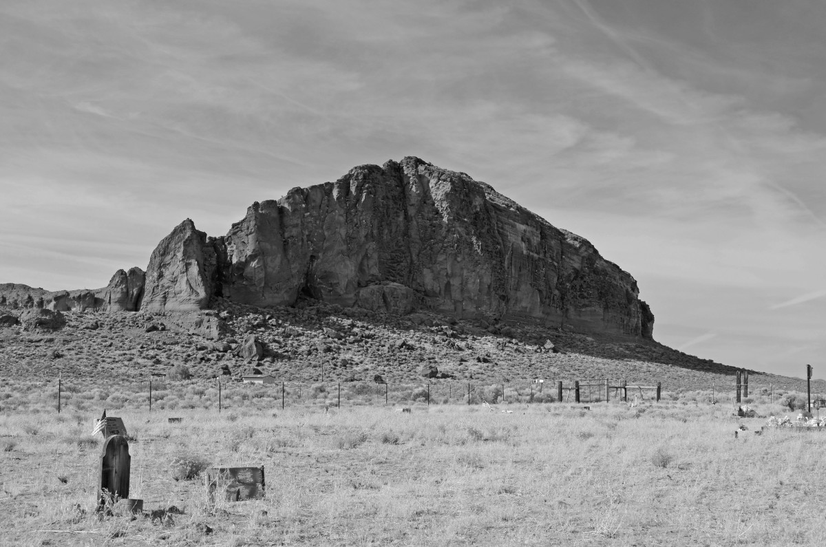 Fort Rock Cemetery on the outskirts of the volcanic rock formation.