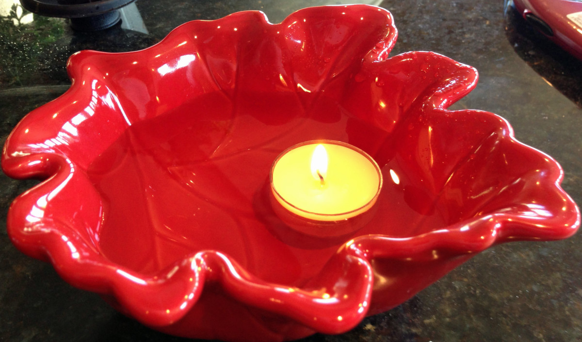 Simple tealights will float.  Then all you need is a colorful bowl.