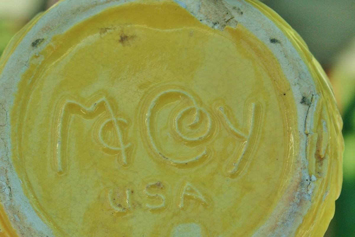 An embossed McCoy marking on the pot bottom.