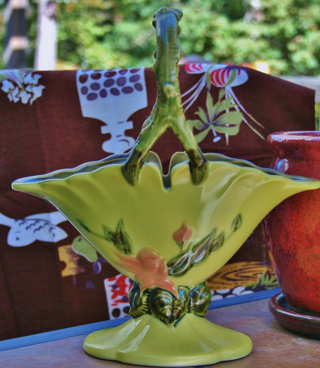 Hull Woodland basket vase/jardinière with faux branch handle and flower design on both sides.