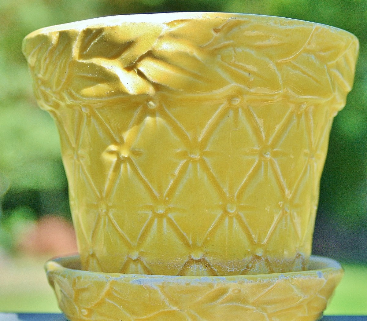 "A small ""leaves & diamonds"" McCoy pot."