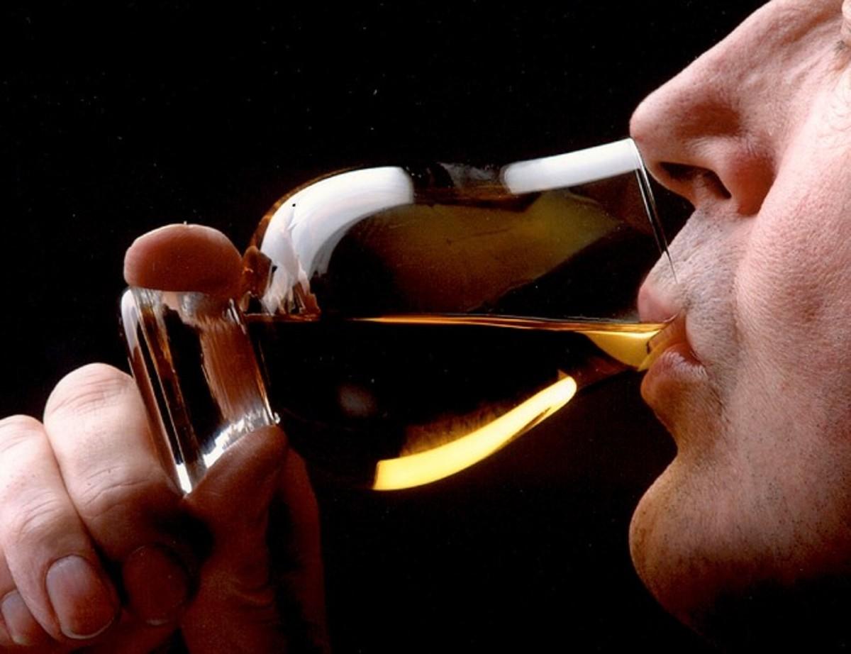Enjoying a whisky from a Glencairn Glass
