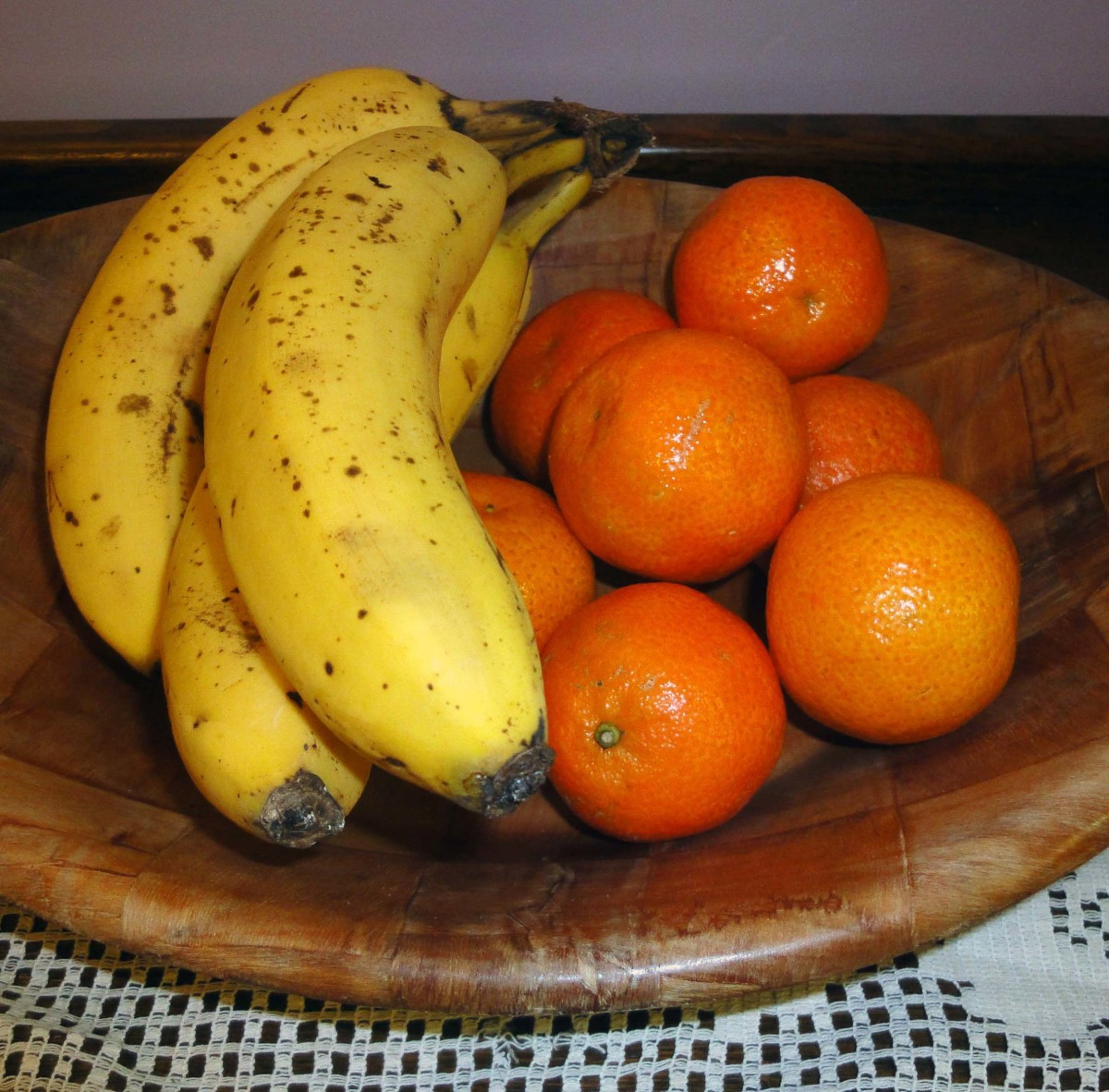 Plaited wooden with oranges and bananas