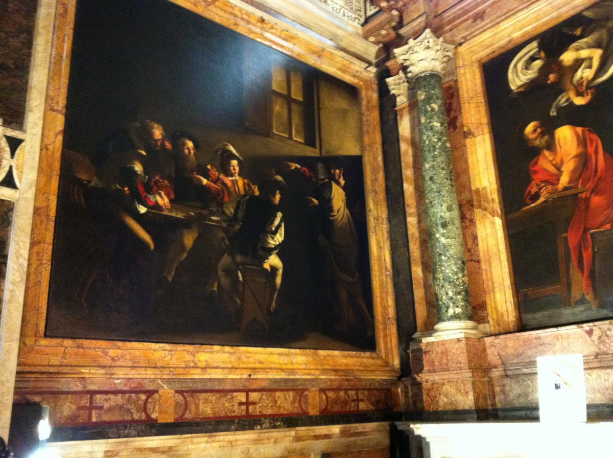 "San Luigi dei Francesi church.  The painting on the left is Caravaggio's ""The Calling of St Matthew"" and a portion of his ""St Matthew and the Angel"" is on the right."