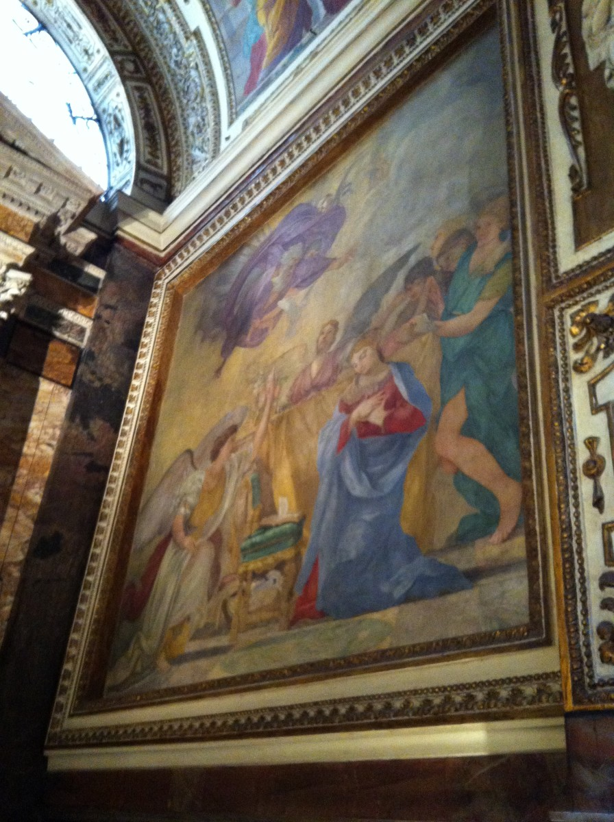 Virgin Mary paintings in the fourth chapel on the left