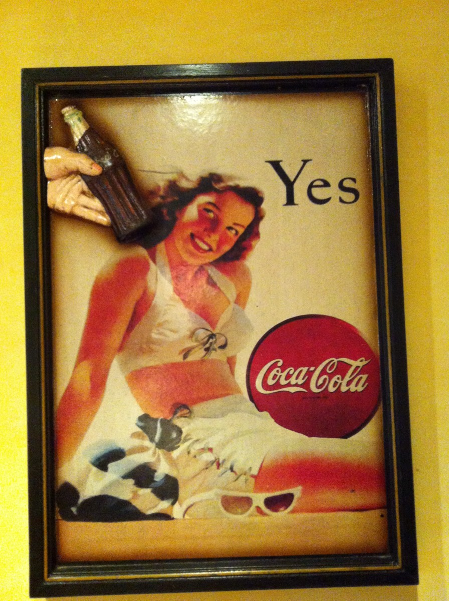 Coca Coca advertising on the walls of the coffee shop bar