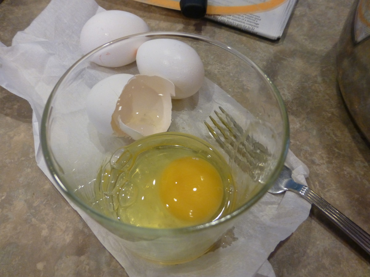 First, crack the egg into a glass. Inspect the top of the yolk and the white.