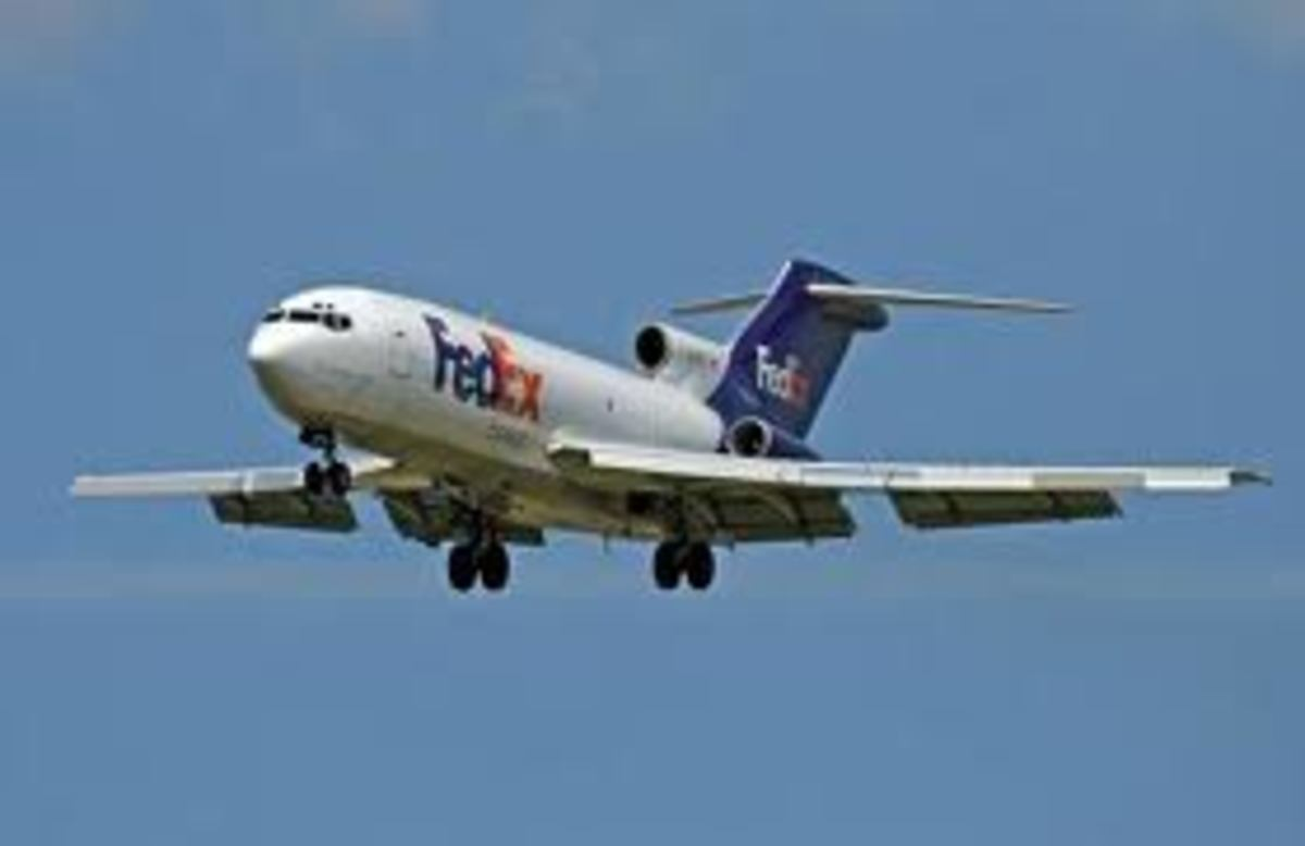 (Note: a FedEx Boeing 727 on approach with leading edge slats and wing flaps extended)