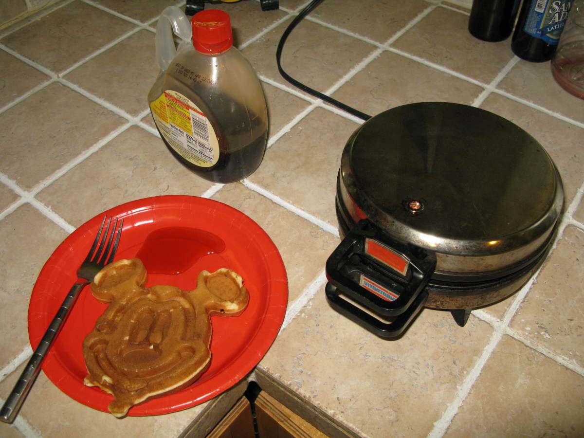 Remove the waffle and use a damp cloth or paper towel to clean.