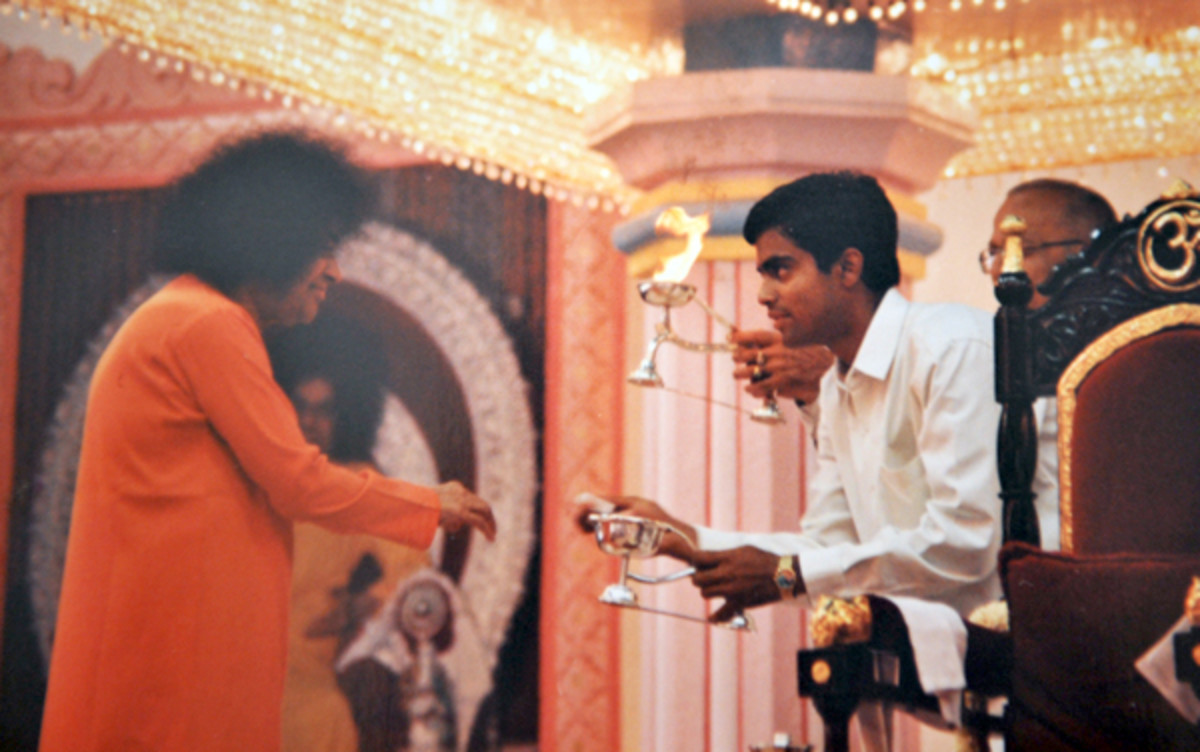 Swami used to 'light' the camphor for quite some time after which He expected the devotee to do the 'lighting' on his own!