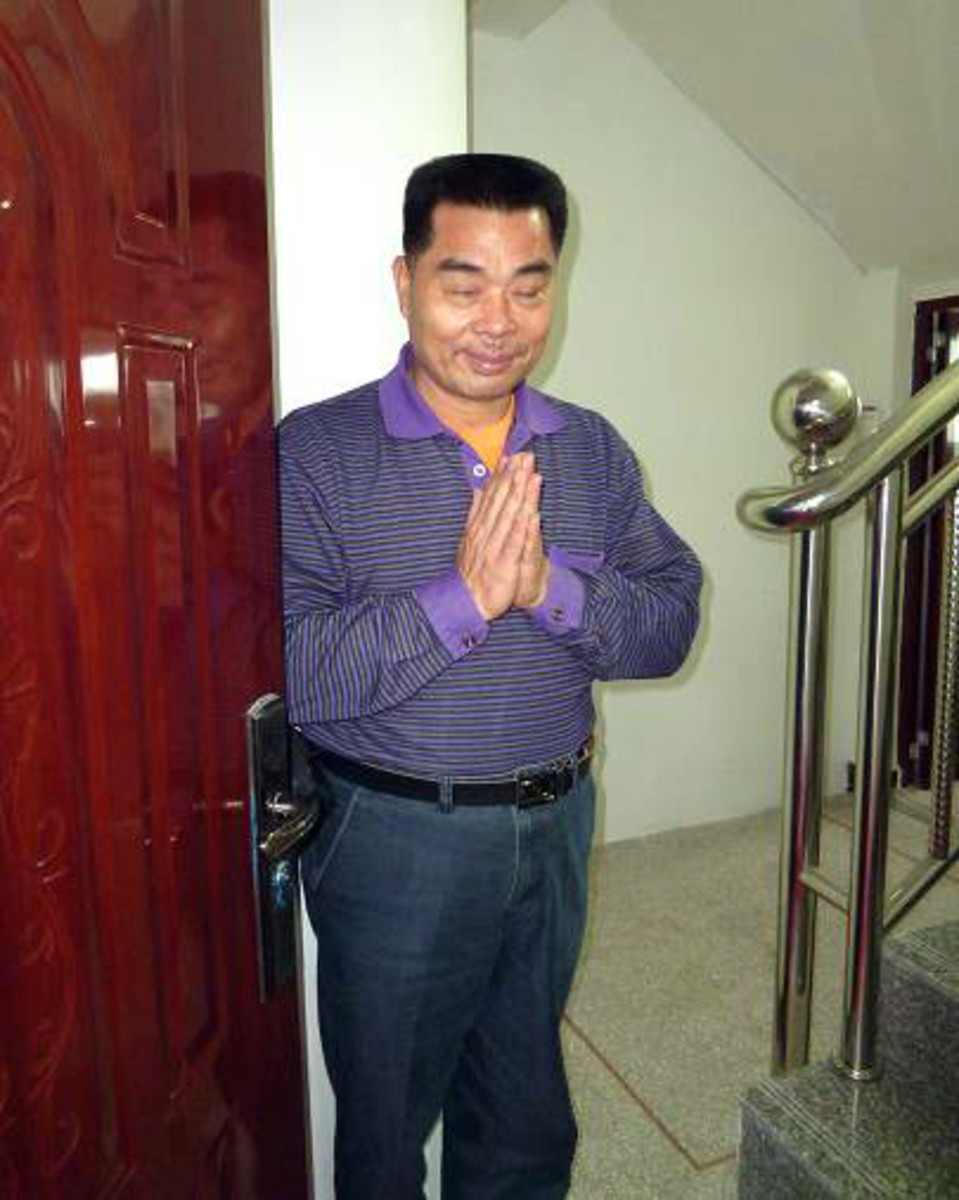 Mr.Xu Xian Li, who takes care of Swami's Centre. His faith is so firm that he actually 'knocks' gently on Baba's door to let Him know that there are visitors coming!