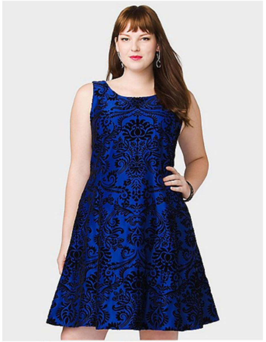 plus size fashion doesn't have to be boring, this simple velvety electric blue cocktail dress with black scroll pattern is guaranteed to dazzle