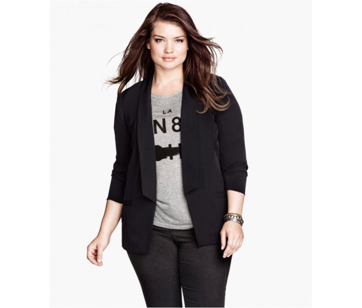 hip length blazer with long lapels, mock pockets at front, and vent at back