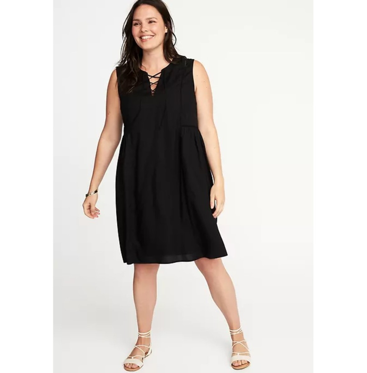 swing dress with rounded split neckline, lace up styling and eyelet trim at front yoke, seamed  shirred back waist