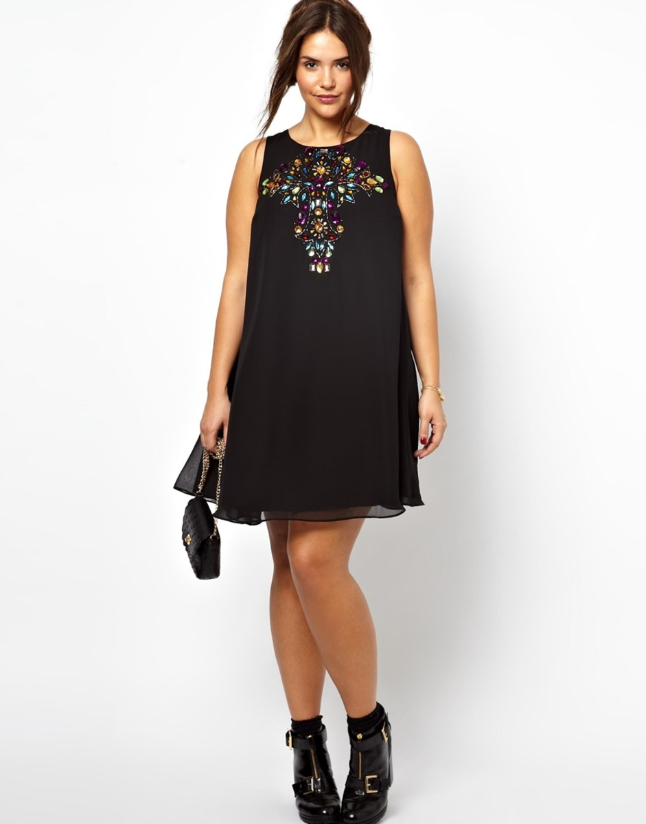 sleeveless chiffon swing dress with stone embellishment on chest
