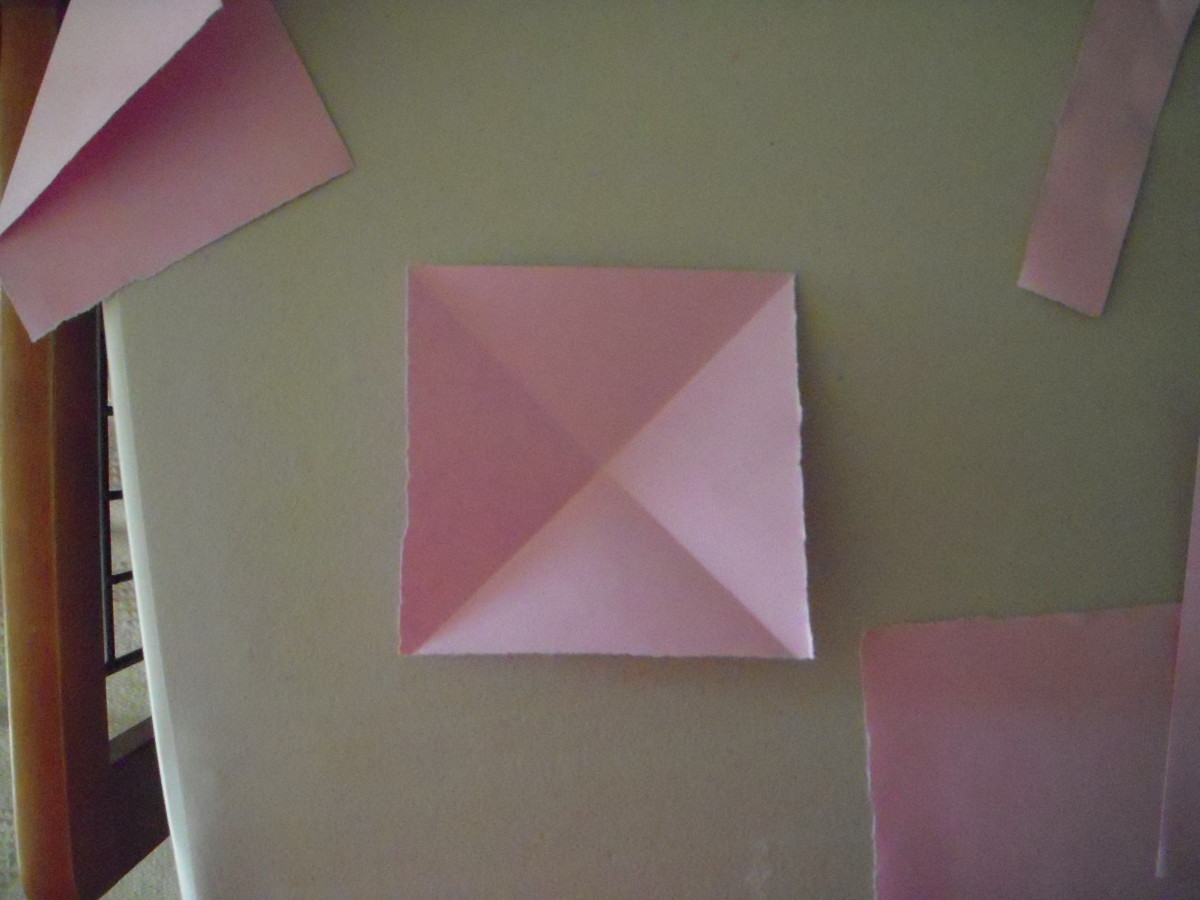 Make diagonal folds, valley style