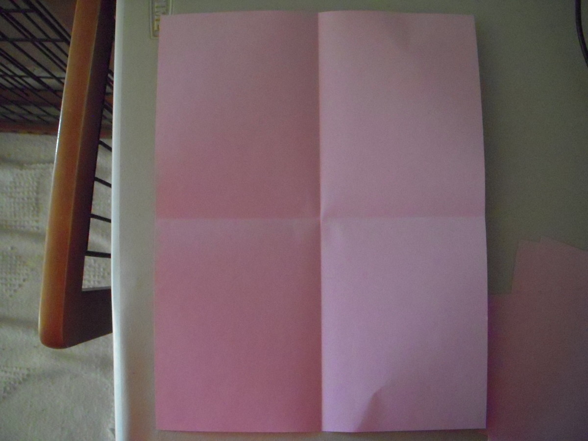 Paper sheet, folded into fourths.
