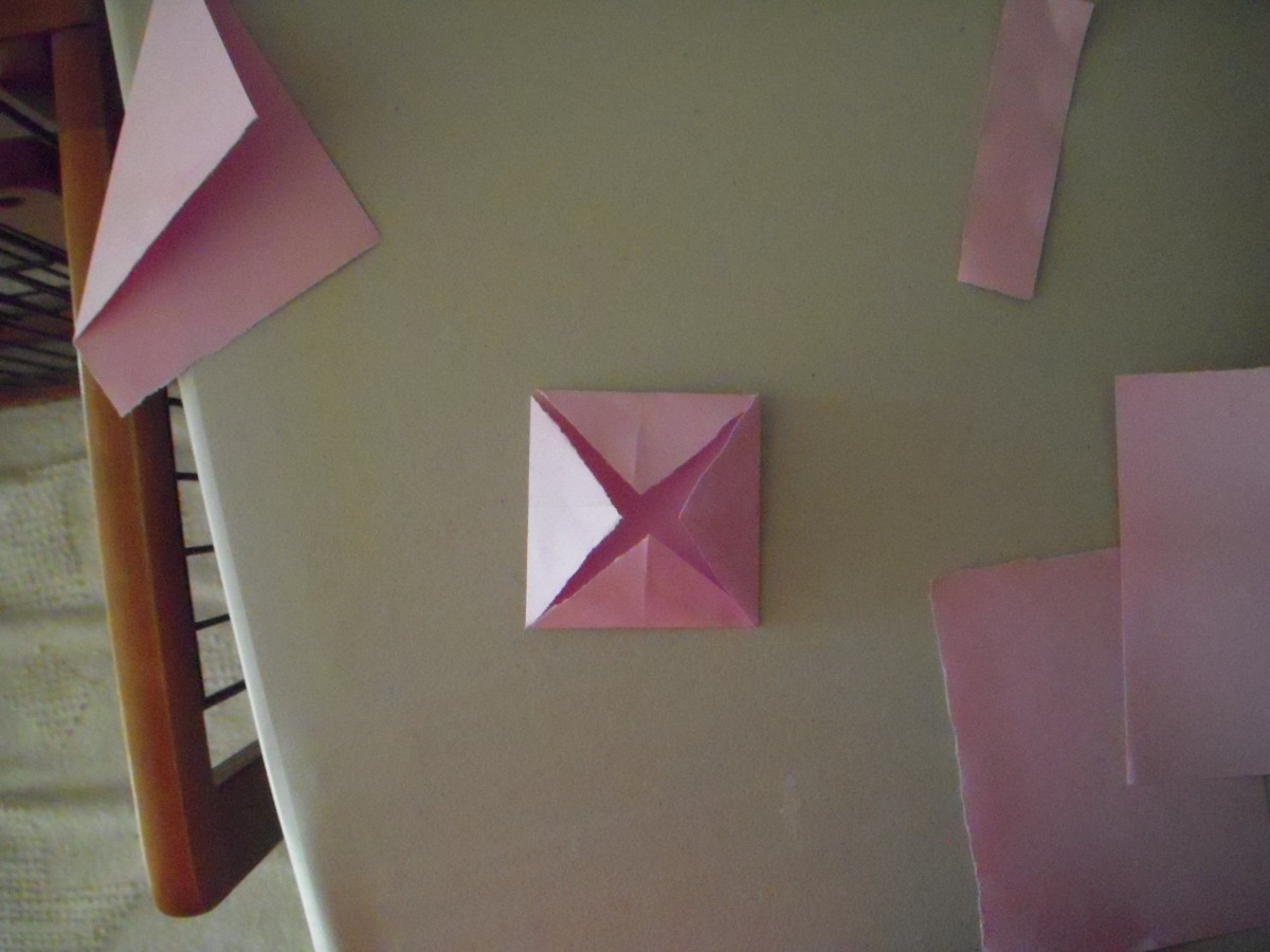 Fold corners to center.