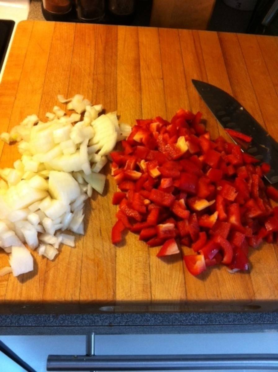 Chop the onion and peppers.