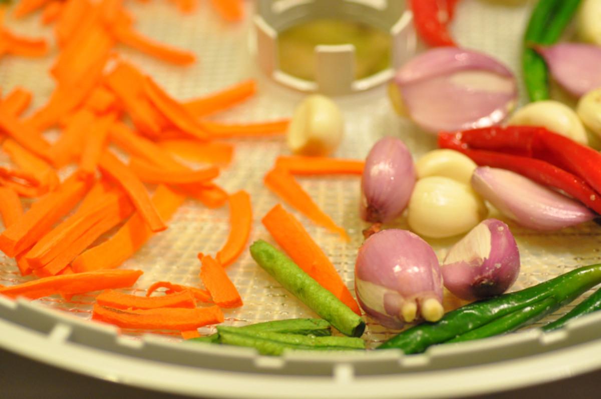 Carrots, chillies, shallots, garlic - after drying. Image: © Siu Ling Hui