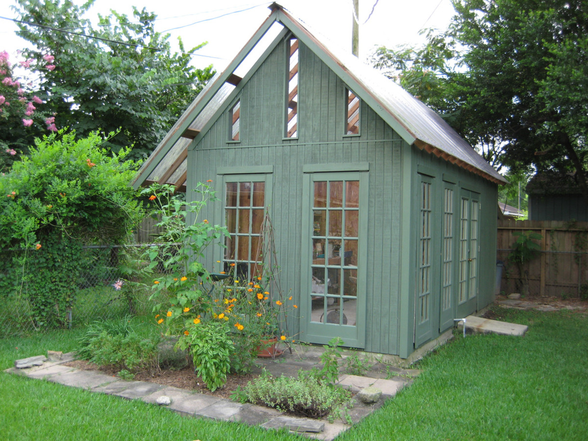 Beautiful Garden Shed with glass windows doors and green siding