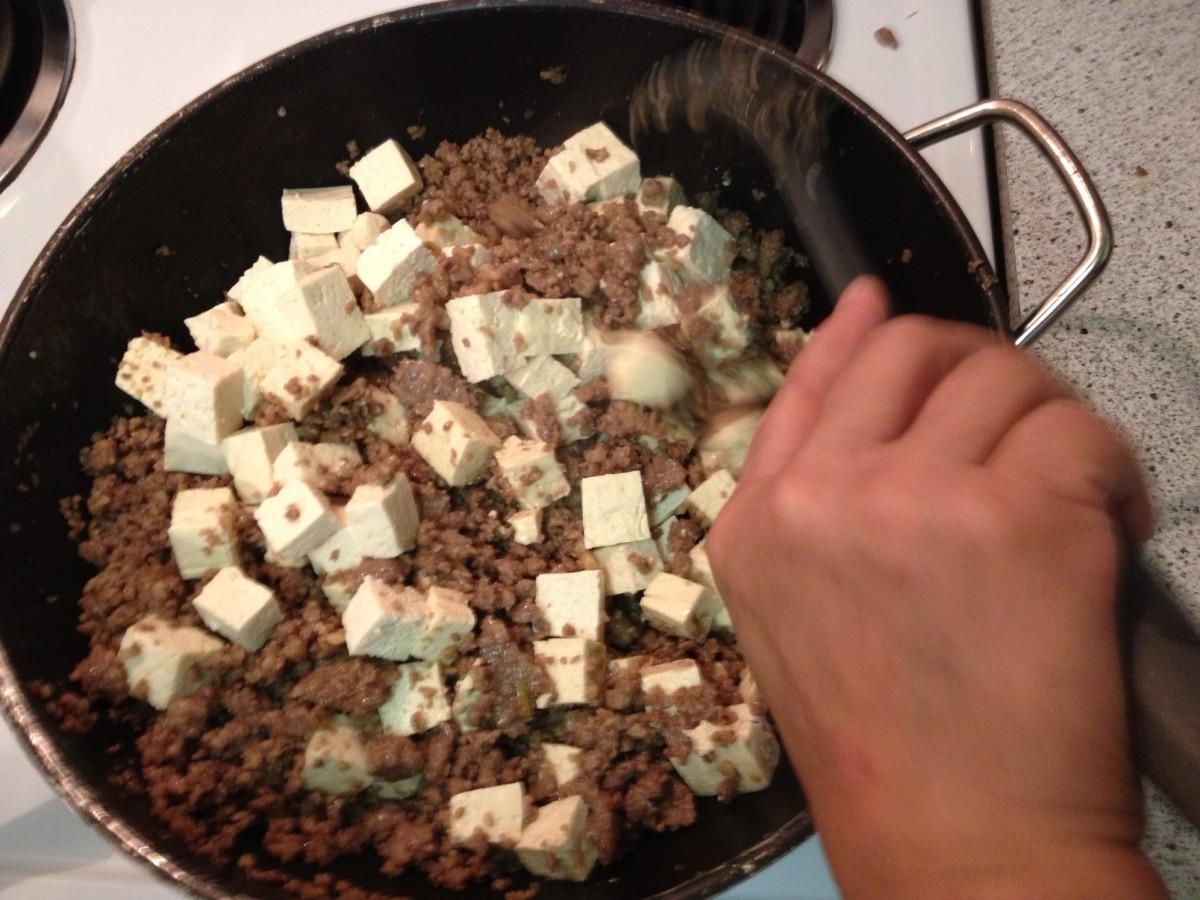 Gently fold tofu into the pork.