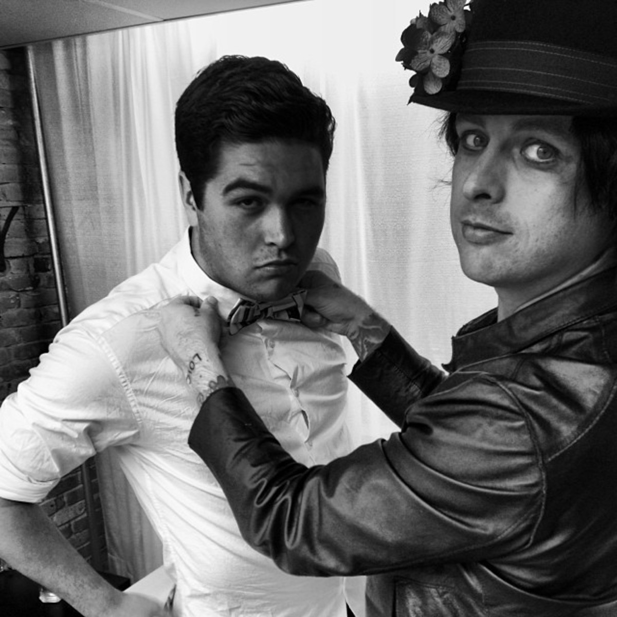 Billie Joe looking as young as his son while putting on a bowtie.