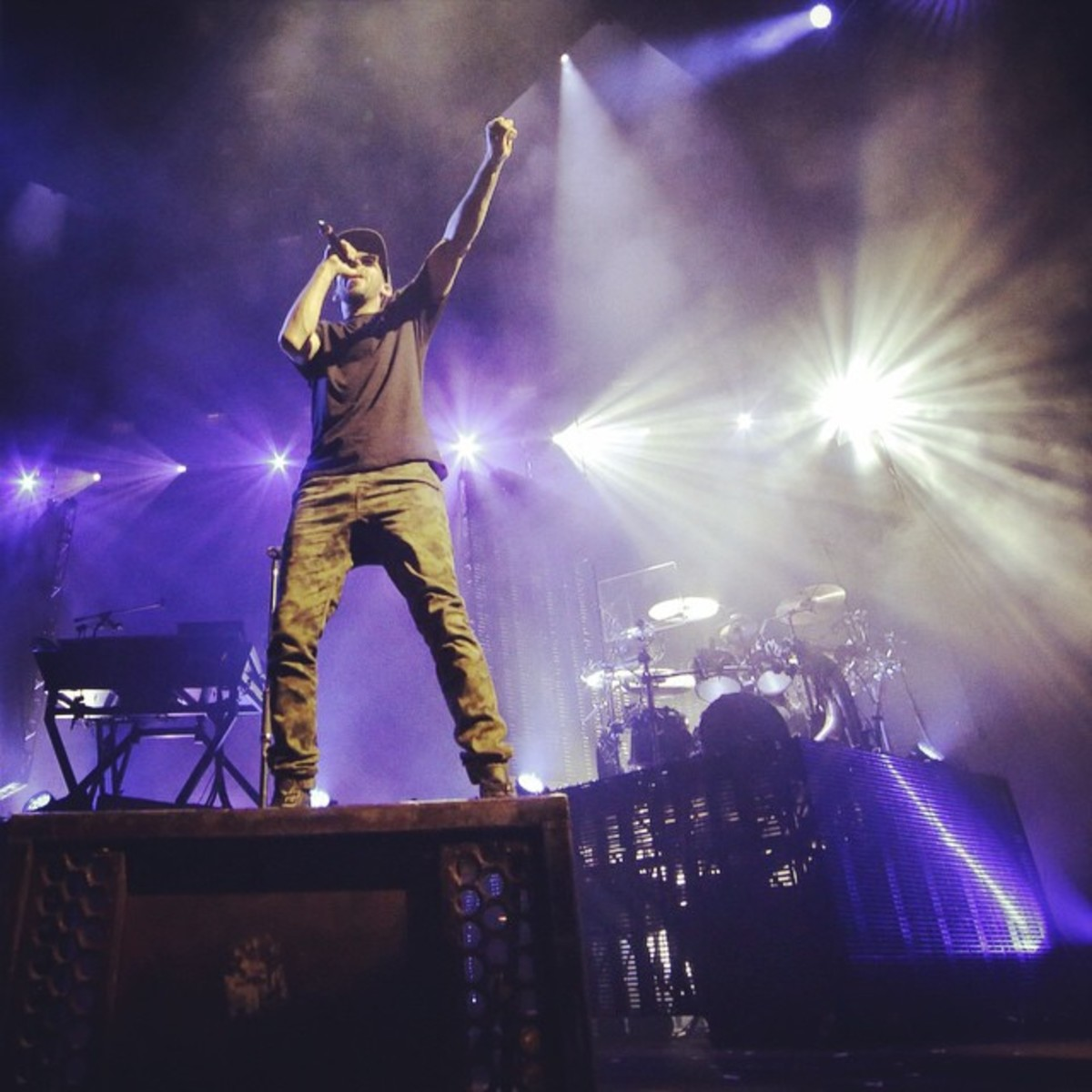 Mike Shinoda on stage with the band
