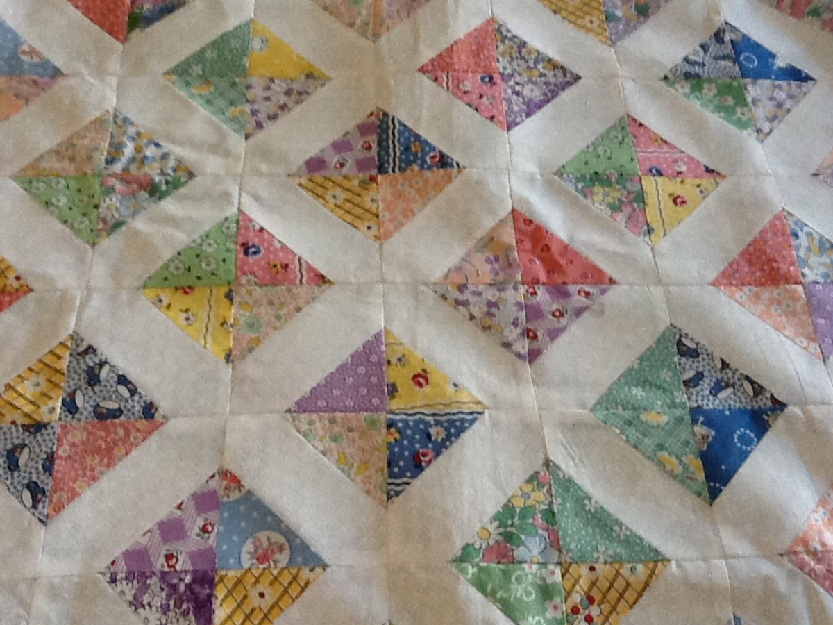 A charm quilt using 1930's reproduction fabrics