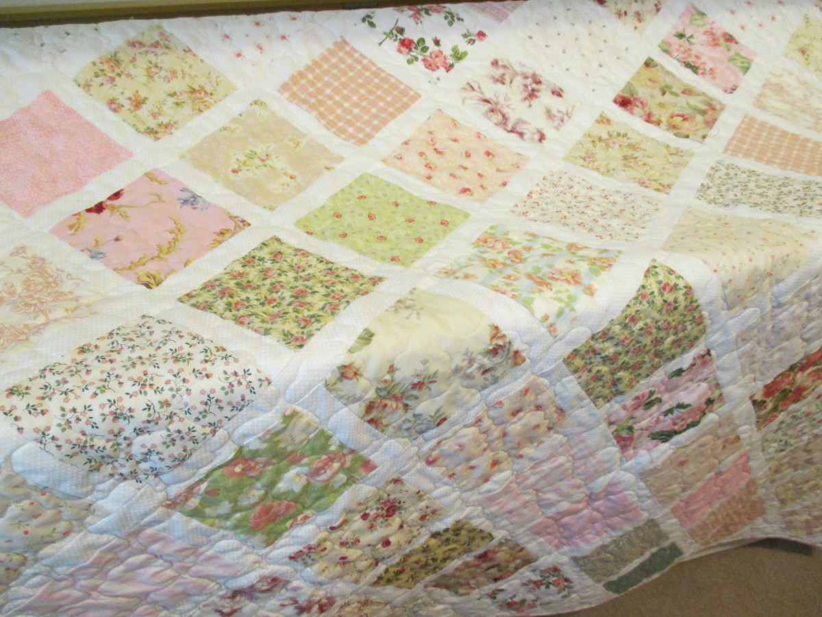 A charm quilt for Maya, using five inch squares and two inch lattice strips
