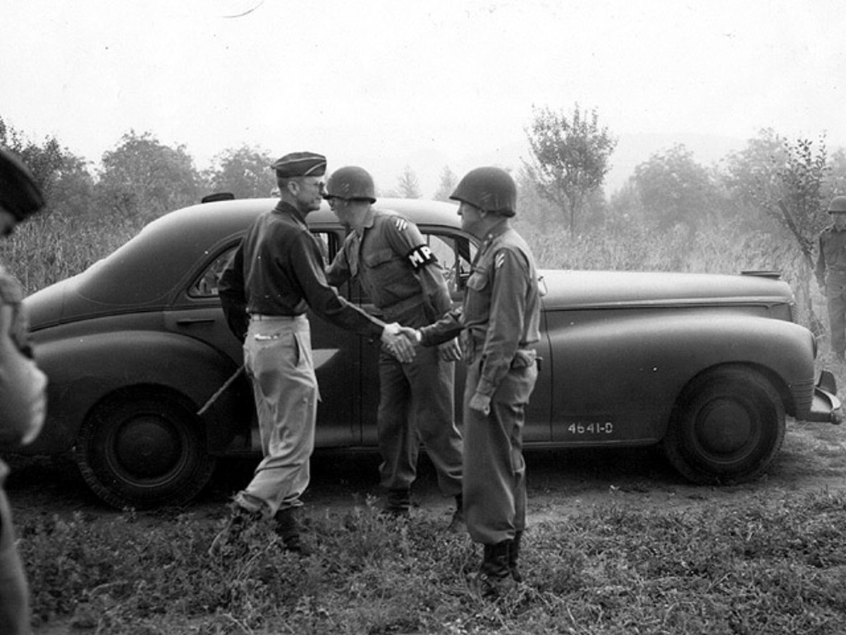 General Alexander Patch (left) greeted by General McDaniel (3rd ID).