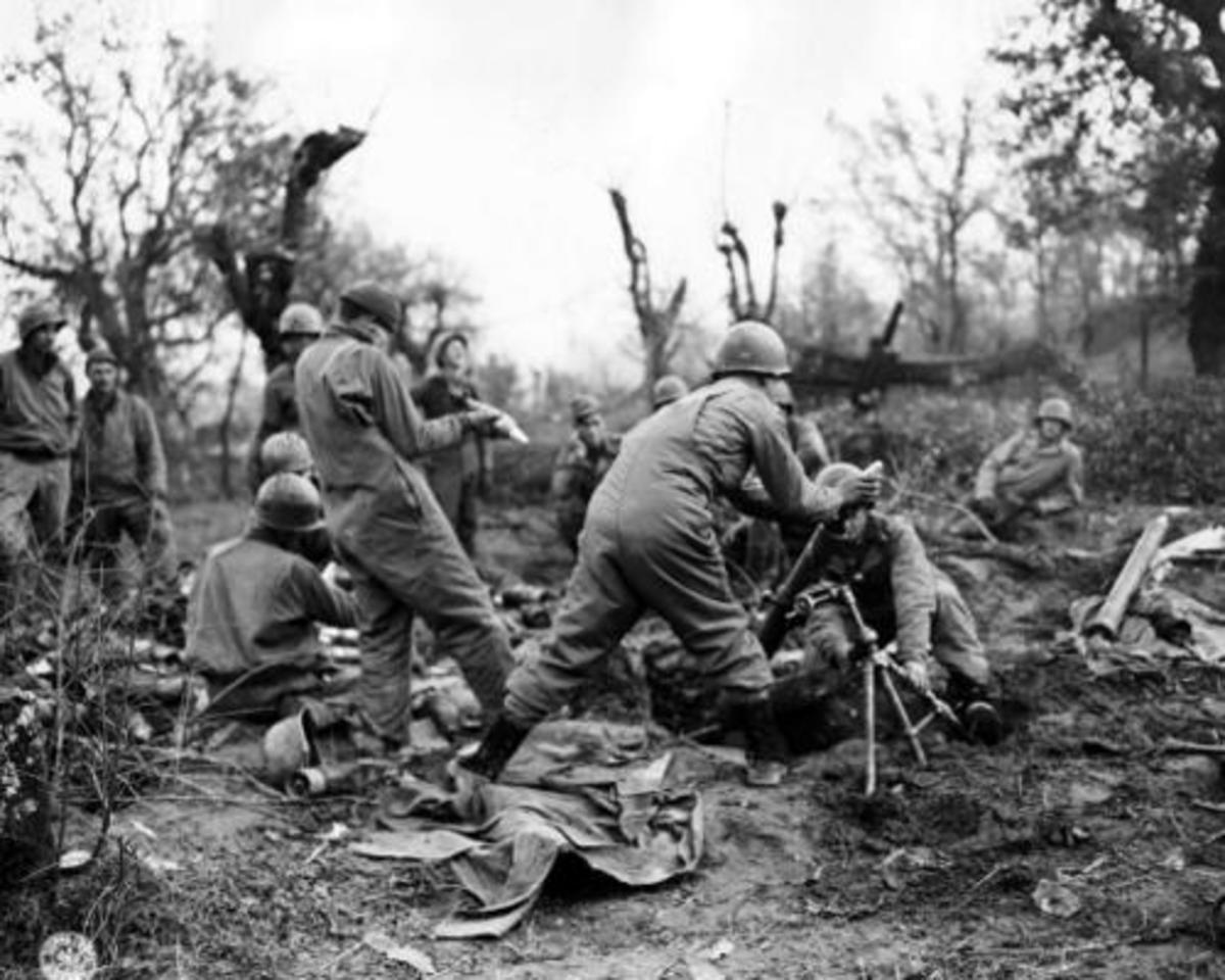 Mortar crew from the 36th ID firing in support of the Rapido River crossing.