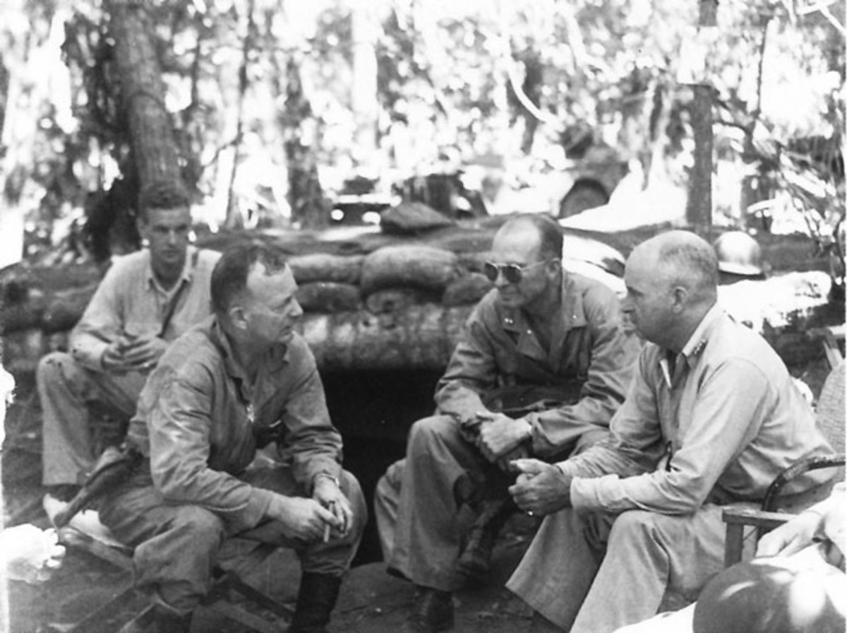 1942-Gen. Patch (center w/shades) on Guadalcanal, seated next to Marine General Vandegrift (right) while being briefed by Marine Col. Hall Jeschke.