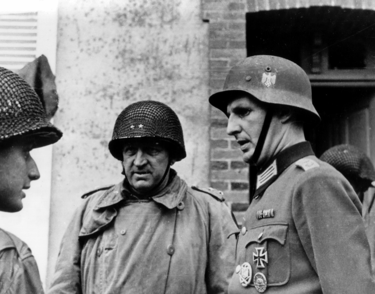 Gen. Eddy, 9th Div CO, with German officer after the capture of Cherbourg, June 1944.