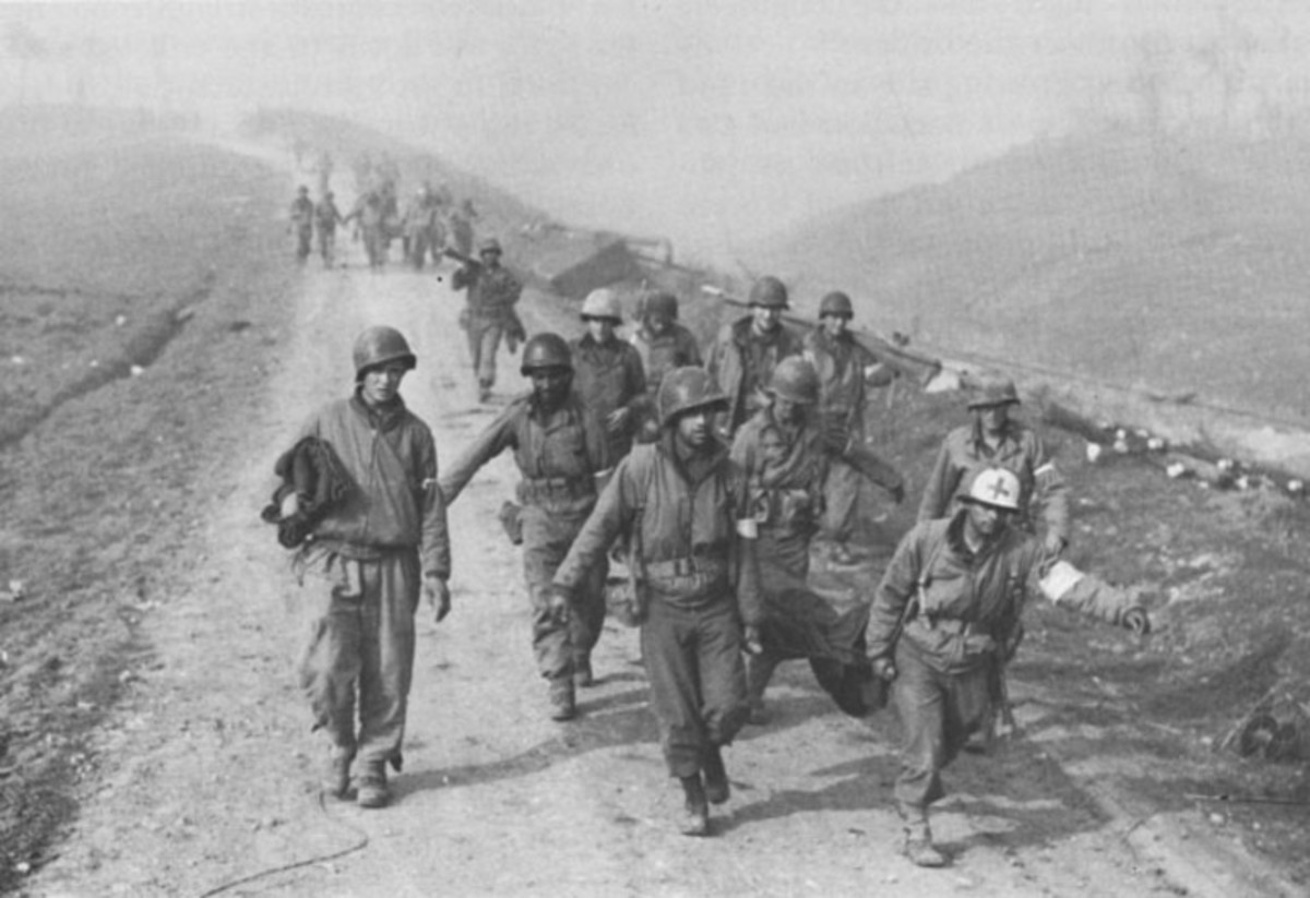 January 1944 - Medics from the 36th Infantry Division haul casualties away from the river crossing.