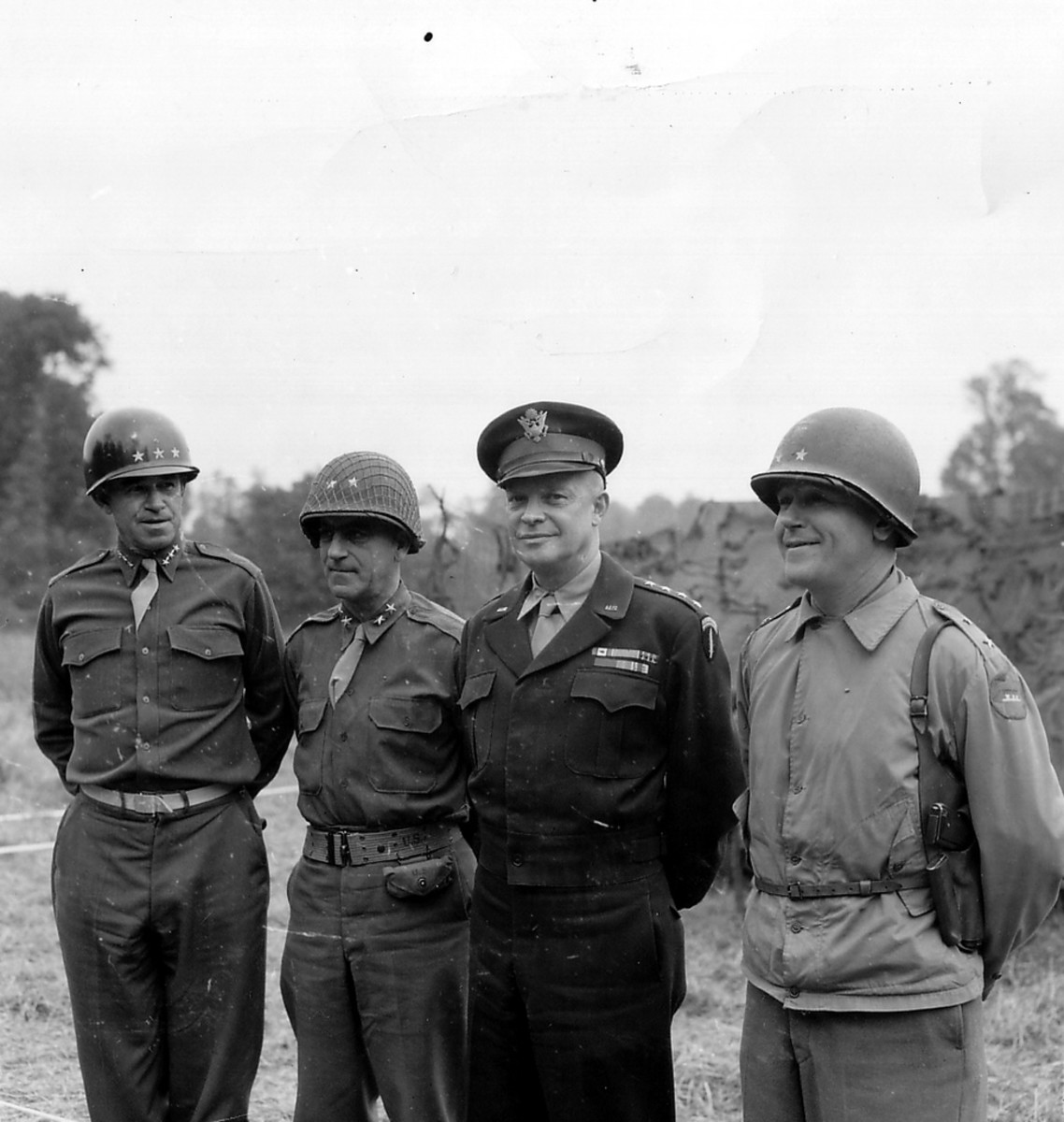 Gen. Gerow (second from left) with Bradley, Ike and Collins. July 1944 in France.