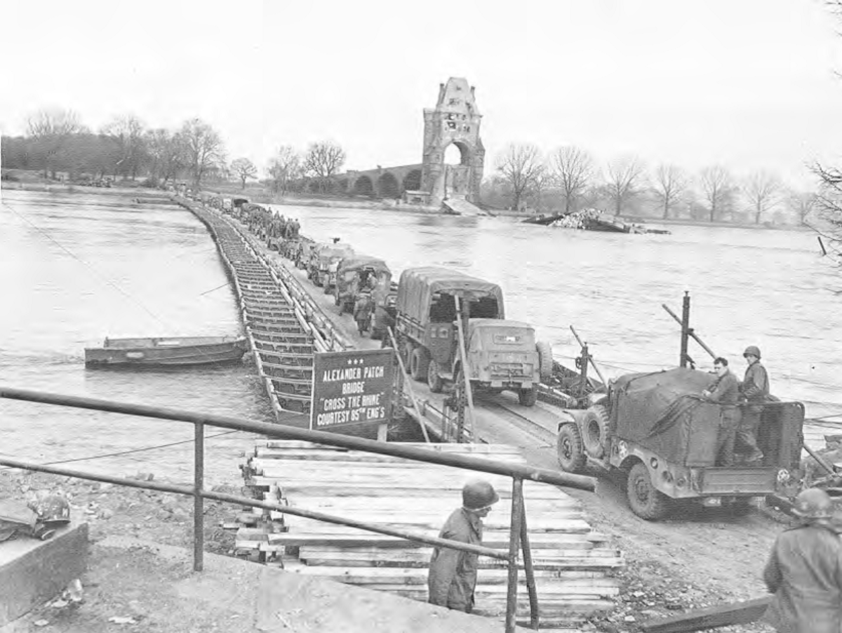 "Patch's 7th Army crossing the Rhine over ""Alexander Patch Bridge."" Note the destroyed stone bridge on the other side of the River."