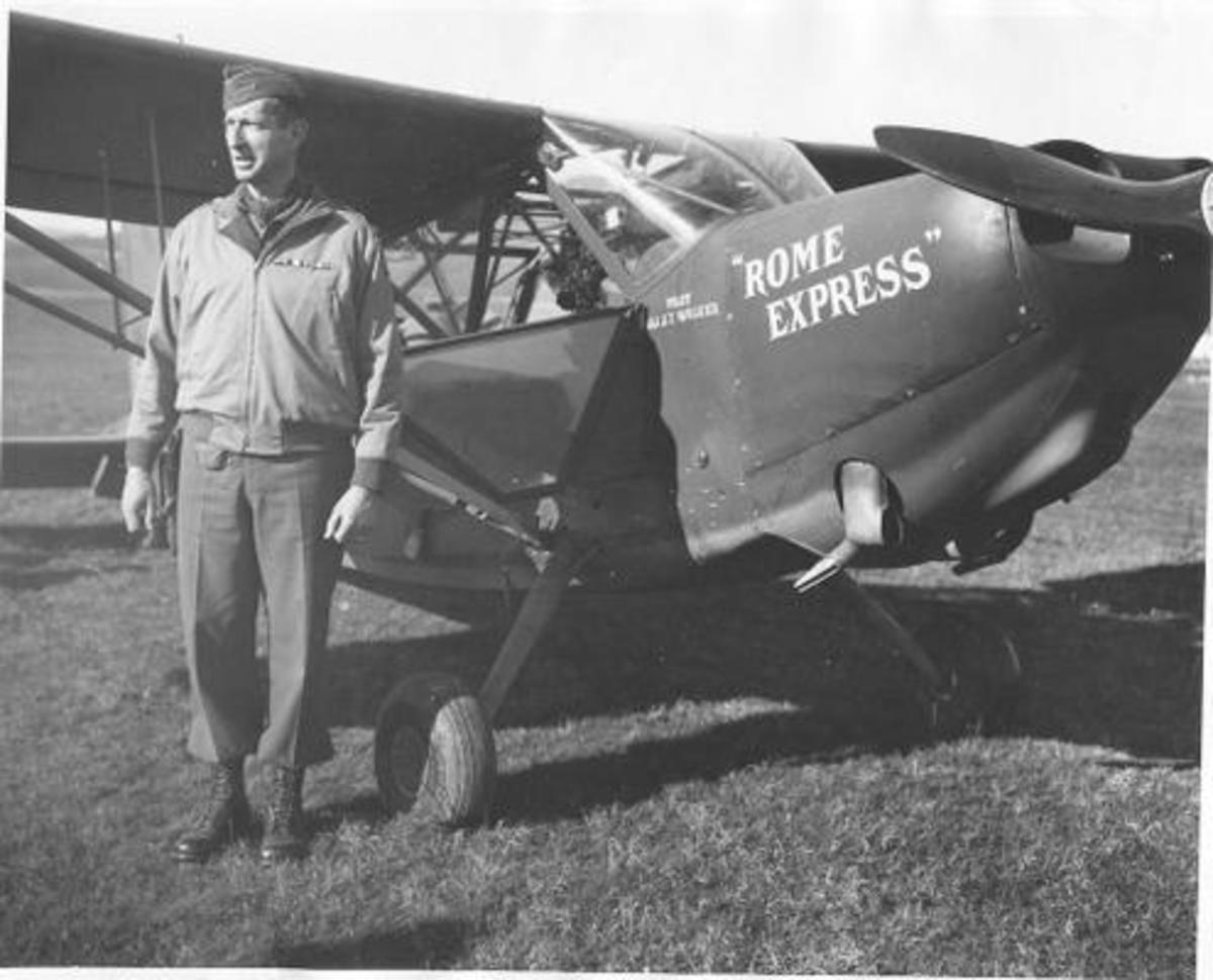 Clark beside his personal plane, 1944. His pilot, Lt. Col. John T. Walker, was killed in Feb. 1945 while flying home in a British transport plane.