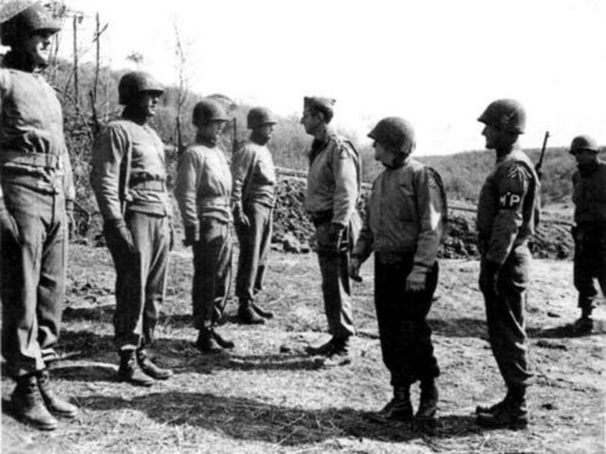 Gen. Clark inspecting 3rd ID soldiers near the Anzio beachhead. Gen. O'Daniel, 3rd ID CO is next to Clark.